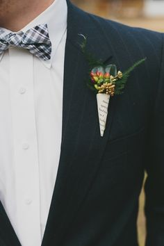 Boutonniere with vintage book page cone.