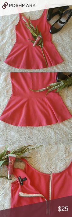 EXPRESS Peplum Tank Top Absolutely adorable EXPRESS Peplum Tank Top, coral in color size xs but can fit a small. Pretty zipper detail on the back as shown in 3rd picture.  Bundles welcome great discounts Please reasonable offers only  ♡Thank you for shopping my closet♡ Express Tops Tank Tops