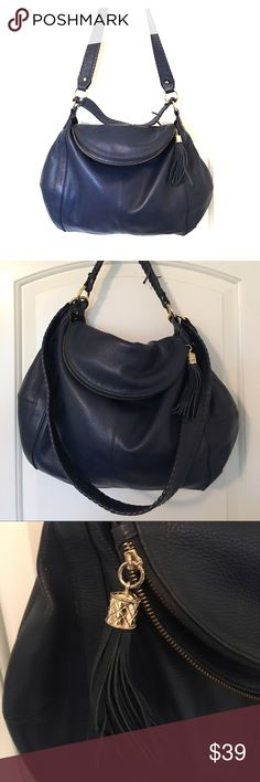 "Onna Ehrlich Rachel Hobo This Onna Ehrlich Famous Rachel Hobo purse is 100% authentic. Dark Navy Leather. Signs of wear on shoulder strap, as seen in picture.   Modern hobo with a classy twist comes in durable leather. Has a roomy interior and an additional long removable hand stitched strap. Main compartment folds over to reveal a zipper closure with an elegant zipper tassel.  Dimensions: 16.25""(L) x 22.5""(W) x 15""(H)  Lining material: cotton Closure: zipper Closure material: gold Fully…"