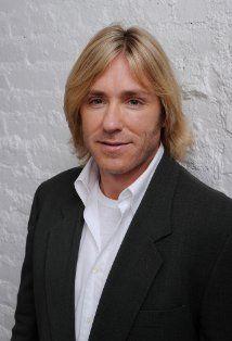 Ron Eldard (Rod Holt)