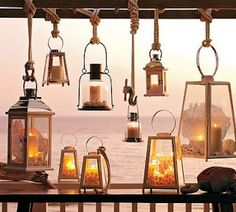lanterns- love the rope knots from which they hang...great on your porch or deck during the summer!