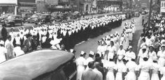 This is a view of the procession that was part of the June 11, 1949, funeral of Sister Stanislaus Malone. One of the largest such events in New Orleans history, the procession included nurses, Daughters of Charity and doctors. Mourners passed Charity Hospital en route to St. Joseph's Church nearby. Archbishop Joseph Francis Rummel was the principal celebrant. (Photo courtesy of the Daughters of Charity)