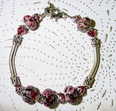 Fuchsia Roses Lampwork, Swarovski Crystals and Sterling Silver Bangle Bracelet. $50.00, via Etsy.