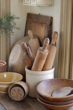 kitchen antiques, rolling pin storage, why didn't I think of this? Wood looks good on the counter (i'm a fan of wooden spoon collections too)