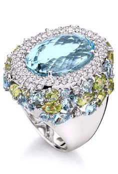 Ring in 18K white gold with round diamonds, aquamarine and peridot.