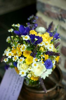 """Wildflower"" Wedding Bouquet: Ivory Spray Roses, Yellow & Yellow/White Feverfew, Purple Anemones, Purple Heather, Blue-Violet Cornflower"