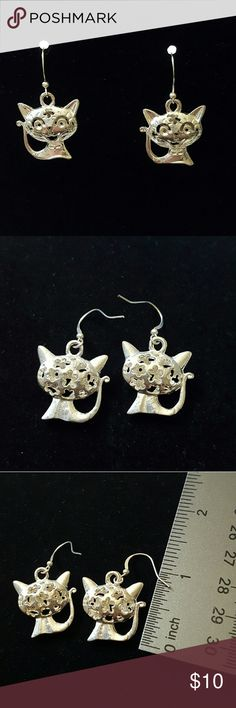 """SILVER TONE CAT EARRINGS Brand new, never worn. Purchased as a gift, but ended up never giving them. Backs have flower shaped cutouts on the heads. Super adorable cats are about 1"""" tall and the entire earring is about 1.5"""" tall. No trades, holds, or Paypal. Jewelry Earrings"""