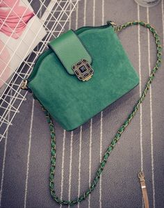 small emerald green jewel tone suede convertible purse/clutch with retro buckle and long chain link removable strap