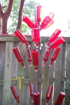 You can pain clear bottles. a Red Bottle Tree-- Where can I get these bottles? Wine Bottle Trees, Wine Bottle Art, Diy Bottle, Blue Bottle, Bottle Crafts, Recycled Bottles, Bottles And Jars, Recycled Glass, Glass Bottles
