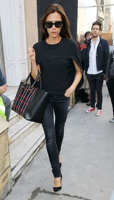 Victoria Beckham wearing R13 Kate Skinny Jeans in Orion Black, Victoria Beckham Liberty Tote and Balenciaga Cady Cape-Top.