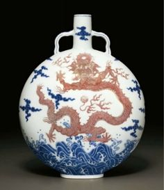 An underglaze-blue and copper-red-decorated 'Dragon' moonflask, Qianlong six-character seal mark in underglaze blue and of the period (1736-1795)