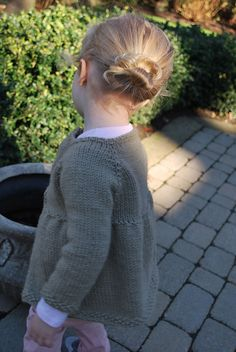 Ravelry: My Favorite Little Girl Knitted Cardigan pattern by A Crafty House?  Knit from the top down, seamless and raglan sleeves.