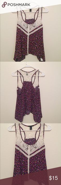 Floral racerback tank top A floral racerback tank top from forever 21 in a size S. The tank is longer on the sides and shorter in the middle on the ends. Never been worn! Forever 21 Tops Tank Tops