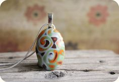 Fantasy pebble.  Polymer clay pendant.  Glass like finish. Mokume gane. Earthy colors. Fall colors.