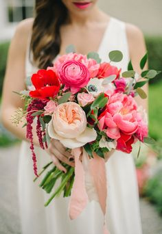 stunning pink and red bouquet featuring peonies, garden roses and ranunculus by Blush & Vine