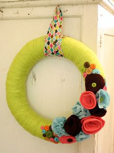 Yarn wrapped wreath with felt flowers