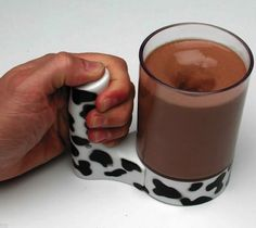 Supreme Moo Mixer - Mix your own chocolate milk with the Supreme Moo Mixer from Hogwild Toys. This 16 ounce Moo Mixer features an easy to use trigger button, an adorable cow-inspired handle, and a large detachable clear tumbler. Drink Mixer, Cool Gadgets, Kitchen Gadgets, Kitchen Tools, Milk, Dishes, Cool Stuff, Creepy Stuff, The Originals