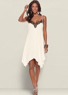 We love the details on this dress! Venus trim detailed dress with Venus embellished thong sandal.
