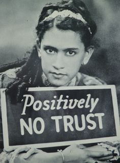 """A striking young woman models with a sign saying, """"Positively NO TRUST"""" -- A slogan commonly seen in stores and saloons in the early decades of the century, meaning, CASH ONLY. Did her lovely face soften the sting? compare to James van Der Zee 1936 Marcus Garvey, James Van Der Zee, American Photo, Harriet Tubman, Harlem Renaissance, Black Image, Famous Photographers, Portraits, Photography Projects"""