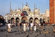 Piazzo di San Marco, Venice, Italy. Venice's largest piazza, Saint Mark's Square, is the city's main meeting place. Lined by cafés and a number of museums, here is the place to get a glimpse of the Venice's glorious architecture and the sea.