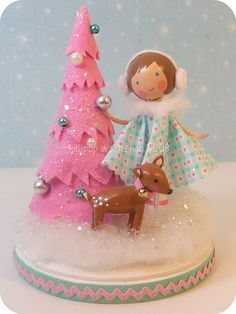 another cute dolly with Christmas tree  Use vintage wooden Christmas mini ornaments and fancy cut felt circles for tree.