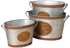 "The Gerson Company Gerson Company Set of 3 Galvanized Metal Buckets With their farmhouse appeal and textured exterior, these ""Pumpkin Patch Farms"" buckets will elevate your fall décor. Each galvanized bucket features two antique copper bands framing its top and bottom. A shiny copper stamp with the phrase ""Pumpkin Patch Farms"" and embossed pumpkins applied in the middle of each bucket. These buckets are perfect for holding your favorite fall flowers or a pile of seasonal gourds."
