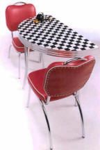 Love it- checkered formica and red chairs!