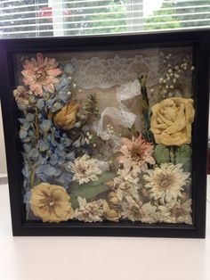 My friend's wedding flowers, dried and arranged in a shadow box