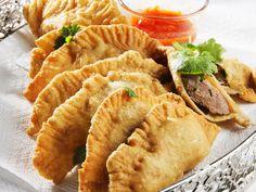 Friterte dumplings med svin og koriander - Kokkeskolen gir deg dumplings – typisk gatemat i Asia, ypperlig til sommerutflukter her hjemme.