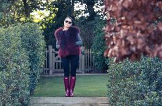 Inside Huggle App Founder Valerie Stark's London Closet: Valerie Stark's closet has one of the biggest CHANEL collections we've ever seen. In collaboration with Huggle. -- Burgundy fur vest and maroon rain boots     coveteur.com