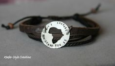 Hand Stamped Africa cut out adoption/mission bracelet on leather corded.  20% of all Africa sales will be going to www.feedingtheorphans.com for their effort to feed and house orphans in Ghana Africa.