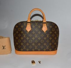 Louis Vuitton Alma Cowhide Satchel in Brown