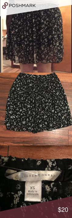 LC Lauren Conrad skirt LC Lauren Conrad skirt. Black with small white flowers. Great condition. It's an XS, but it's stretchy. LC Lauren Conrad Skirts Mini