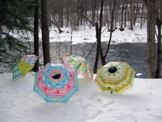 """Trashion Umbrellas. The recycled umbrella is uniquely hand-made. The handle and tip are made from Indonesian native wood, and the edges are lined with silk. The rest of the umbrella is made from recycled trash that is collected by scavengers, triple washed, then """"artfully collaged"""" together"""