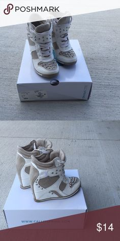 Call It Spring white grommet wedge tennis shoe Gently used, worn a few times Call It Spring Shoes Wedges