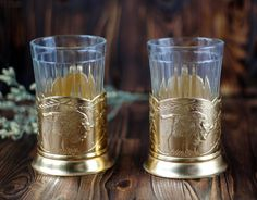 Excited to share the latest addition to my #etsy shop: Set of 2 Vintage Soviet Russian Tea Glasses & Holders Golden Bison Traditional Russian Fall Hunting Scene Podstakannikn Granyonyi stakan http://etsy.me/2FaYHfi #housewares #gold #housewarming #christmas #clear #met