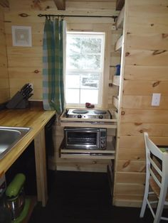 Interesting idea, putting kitchen appliances on drawers. Brevard Tiny House Company