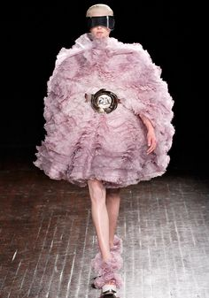 "Alexander McQueen : Fall 2012 Ready to Wear  Sarah Burton has been thinking about ""a beautiful future"" for fall: ""A kind of soft futurism. Not cold and structured, but optimistic and forward-looking."" -- Vogue"