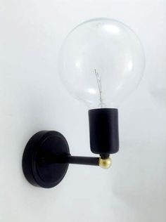 Handmade Industrial style simple wall sconce mounted light in black and white with gold details. Very stylish design suitable for dinning rooms,