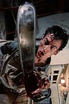 The protagonist of evil dead 2 with his signature chainsaw, I love the bizzare camera tilt and how it makes the audience feel kinda mad