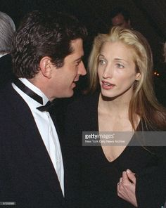 John F Kennedy Jr chats with his girlfriend Carolyn Bessette at the  Municipal Art Society of
