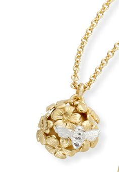 A delicate domed posy of flowers provides the perfect spot for the tiny gold bee on this silver necklace. http://www.annabelchaffer.com/products/Silver-Bee-Necklace.html