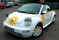 car wrap flowers | Yellow Vinyl Flowers and Matte Black TEXT