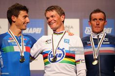 Adriano Malori of Italy, Vasil Kiryienka of Belarus and Jerome Coppel of France celebrate on the podium after the Elite Men Time Trial on day five of the UCI Road World Championships on September 23, 2015 in Richmond, Virginia.