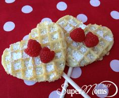 Happy Heart Waffle Pops - Get your heart-shaped cookie cutters ready and have fun making these simply, super breakfast treats on a stick. Tags: Valentine's Day breakfast ideas | easy Valentine's Day recipe | Valentine's Day treats for kids | SuperMoms360.com