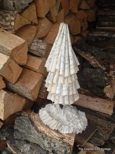 Use old sheet music to make a vintage Sheet Music Tabletop Christmas Tree. This homemade tabletop Christmas tree is a beautiful decoration for your home.