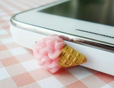 Soft icecream earphone plug - Strawberry. $3.75, via Etsy.