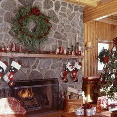Unite with Color: With such a stunning gabbro stone fireplace, the mantel needs minimal embellishment. Match crimson candles to the ribbon used in the fresh fir wreath to establish your color palette. Intertwine the ribbon with the candles to enhance the burst of color. Ribbon and candles available at craft supply stores.