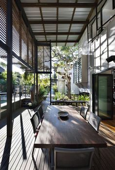 The covered double height outdoor space of the house.