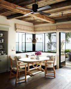 wooden ceiling and black ceiling fan